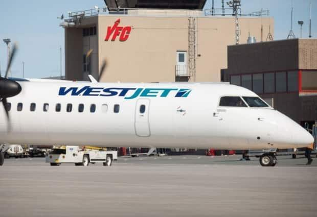 WestJet announced Wednesday that it will resuming service to airports in Atlantic Canada, including Fredericton and Moncton, and in Quebec. (Fredericton International Airport Authority - image credit)