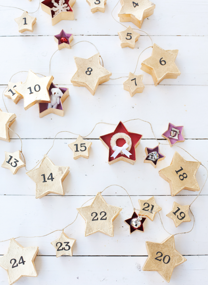 """<p>The kids will love this unique Christmas garland, since it functions as an advent calendar. Each box holds a special surprise as you count down to Christmas. </p><p><a href=""""https://abeautifulmess.com/star-garland-advent-calendar/"""" rel=""""nofollow noopener"""" target=""""_blank"""" data-ylk=""""slk:Get the tutorial."""" class=""""link rapid-noclick-resp"""">Get the tutorial.</a></p><p><a class=""""link rapid-noclick-resp"""" href=""""https://www.amazon.com/Factory-Direct-Craft-Small-Paper/dp/B003F0IZD6/?tag=syn-yahoo-20&ascsubtag=%5Bartid%7C10072.g.37499128%5Bsrc%7Cyahoo-us"""" rel=""""nofollow noopener"""" target=""""_blank"""" data-ylk=""""slk:SHOP BOXES"""">SHOP BOXES</a></p>"""