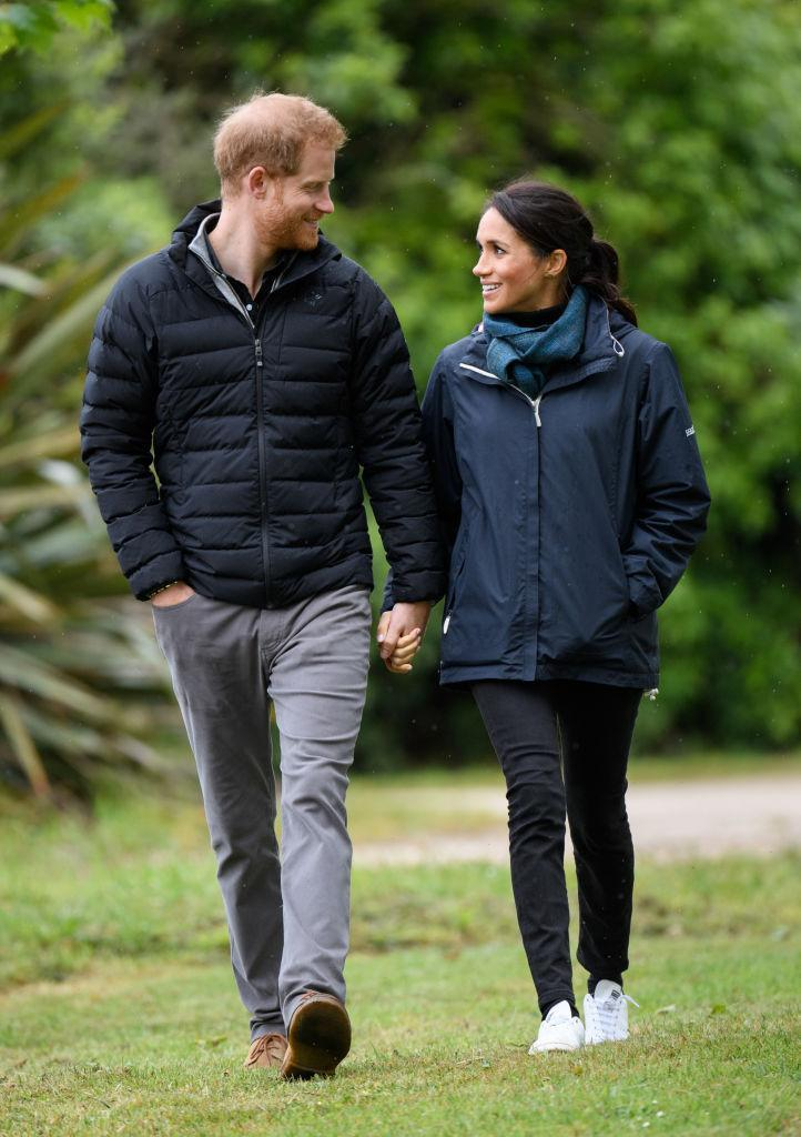 Prince Harry and Meghan Markle, who is wearing Stella McCartney's vegan take on Stan Smith sneakers, visit Abel Tasman National Park in New Zealand. (Photo: Getty Images)