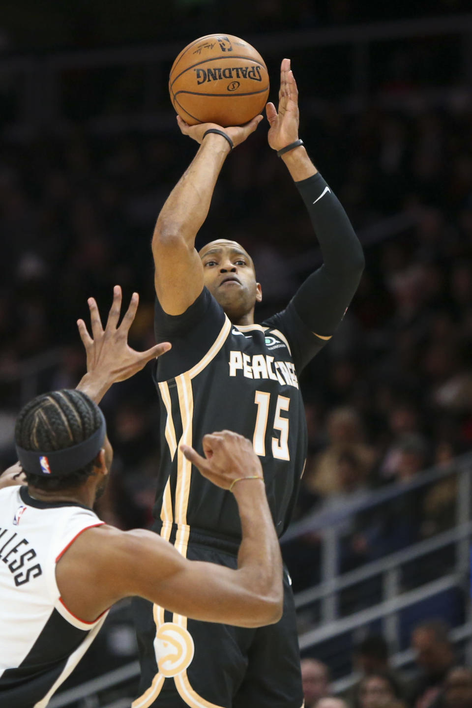 Atlanta Hawks guard Vince Carter (15) shoots over Los Angeles Clippers forward Maurice Harkless (8) in the first half of an NBA basketball game Wednesday, Jan. 22, 2020, in Atlanta, Ga. (AP Photo/Brett Davis)