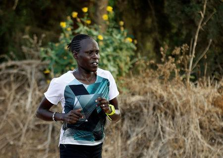Lonah Chemtai, a Kenyan-born runner who will represent Israel in the women's marathon at the 2016 Rio Olympics trains with her husband and coach, Israeli Dan Salpeter, near their house in Moshav Yanuv, central Israel July 14, 2016. REUTERS/Baz Ratner