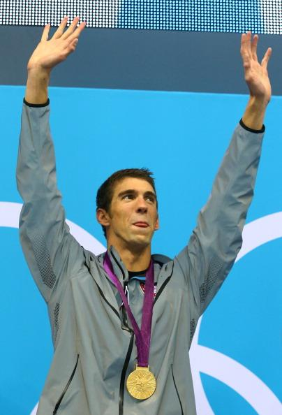 LONDON, ENGLAND - AUGUST 04:  Gold medallist Michael Phelps of the United States celebrates on the podium in the medal ceremony for the Men's 4x100m medley Relay Final on Day 8 of the London 2012 Olympic Games at the Aquatics Centre on August 4, 2012 in London, England.  (Photo by Al Bello/Getty Images)