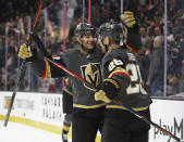 Vegas Golden Knights center Paul Stastny (26) celebrates with teammate Max Pacioretty (67) after Stastny scored during the second period of the team's NHL hockey game against the Calgary Flames on Saturday, Oct. 12, 2019, in Las Vegas. (AP Photo/Benjamin Hager)
