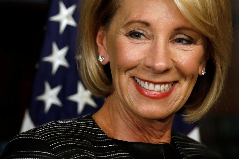 Betsy DeVos waits to be sworn-in as U.S. Education Secretary at the Eisenhower Executive Office Building at the White House in Washington, U.S. February 7, 2017. REUTERS/Jonathan Ernst     TPX IMAGES OF THE DAY