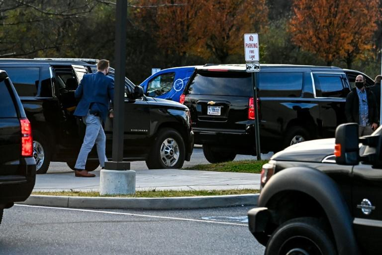A vehicle carrying US President-elect Joe Biden arrives at Delaware Orthopaedic Specialists Clinic in Newark, Delaware