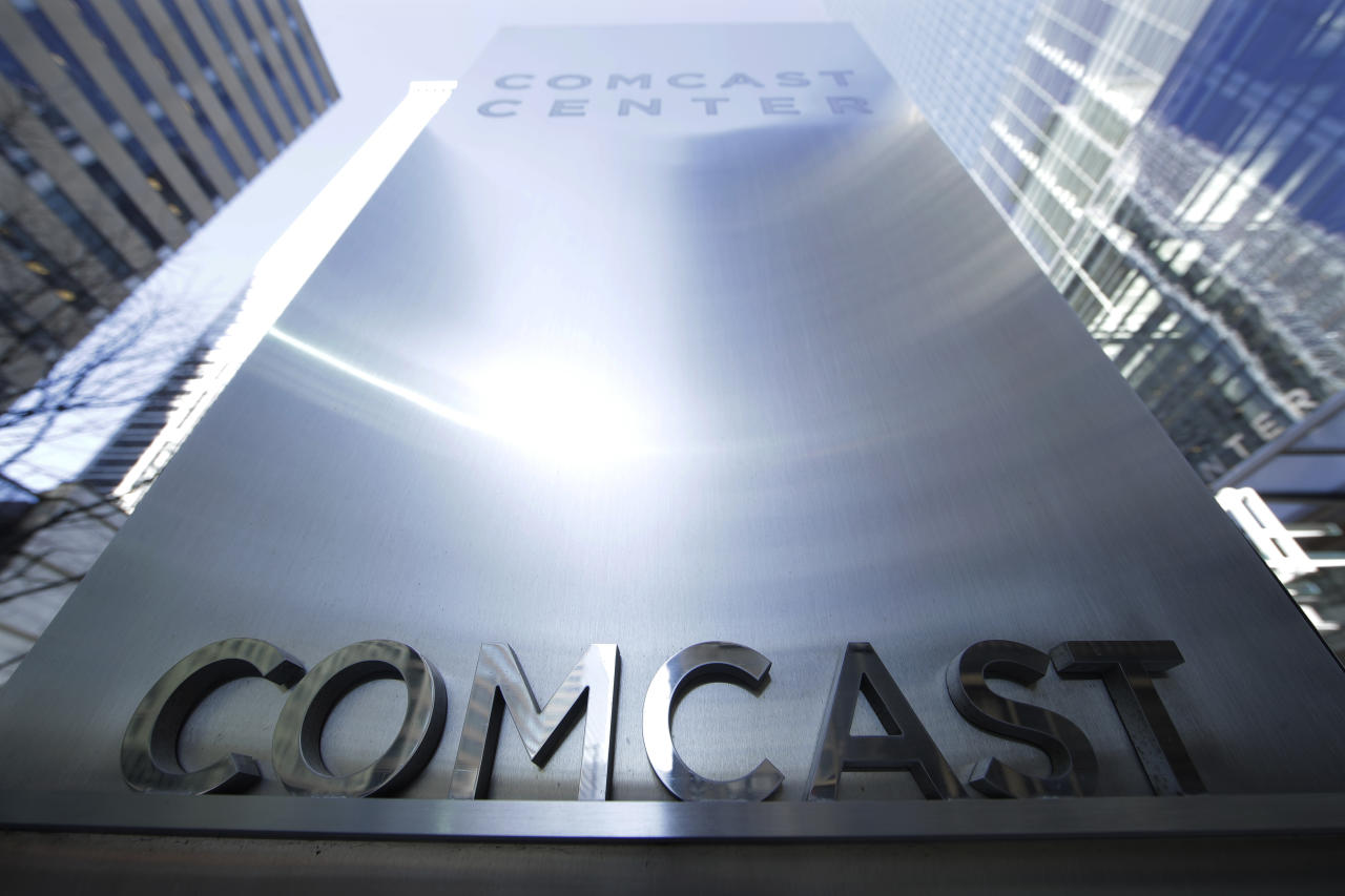 FILE -This March 29, 2017 file photo shows a sign outside the Comcast Center in Philadelphia. British regulator says Comcast has won an auction to formally bid for broadcaster Sky, on Saturday, Sept. 22, 2018. (AP Photo/Matt Rourke)