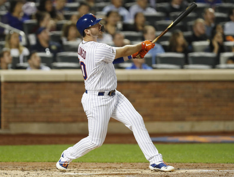 New York Mets' Pete Alonso (20) watches his three-run home run in the second inning of the team's baseball game against the Miami Marlins, Wednesday, Sept. 25, 2019, in New York. (AP Photo/Kathy Willens)