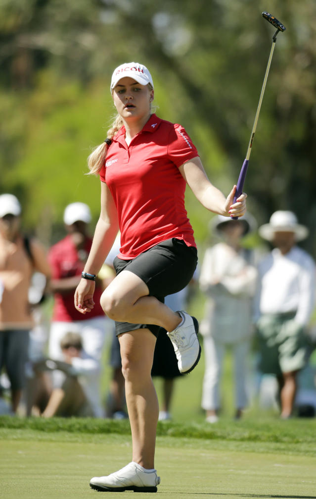 Charley Hull, of England, reacts after missing a birdie putt on the fourth hole during the final round of the Kraft Nabisco Championship golf tournament Sunday, April 6, 2014, in Rancho Mirage, Calif. (AP Photo/Chris Carlson)