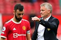 Manchester United boss Ole Gunnar Solskjaer consoles Bruno Fernandes after he missed a penalty in United's 1-0 defeat by Aston Villa (AFP/Paul ELLIS)