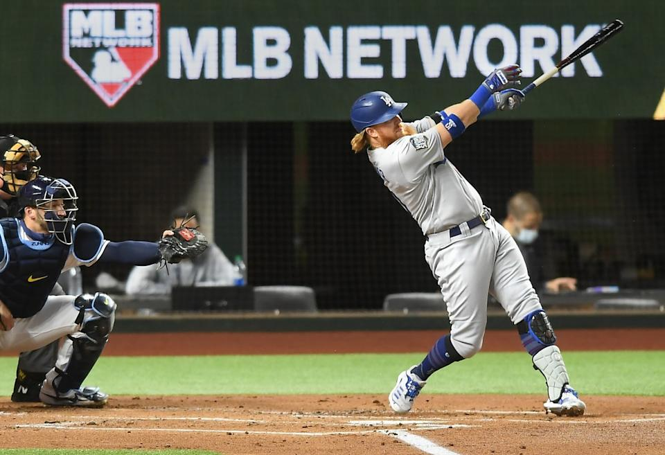 The Dodgers' Justin Turner hits a first-inning solo home run in Game 3 of the World Series.