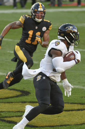 Baltimore Ravens linebacker Tyus Bowser (54) runs past Pittsburgh Steelers wide receiver Chase Claypool (11) after making an interception during the first half of an NFL football game, Wednesday, Dec. 2, 2020, in Pittsburgh. (AP Photo/Don Wright)