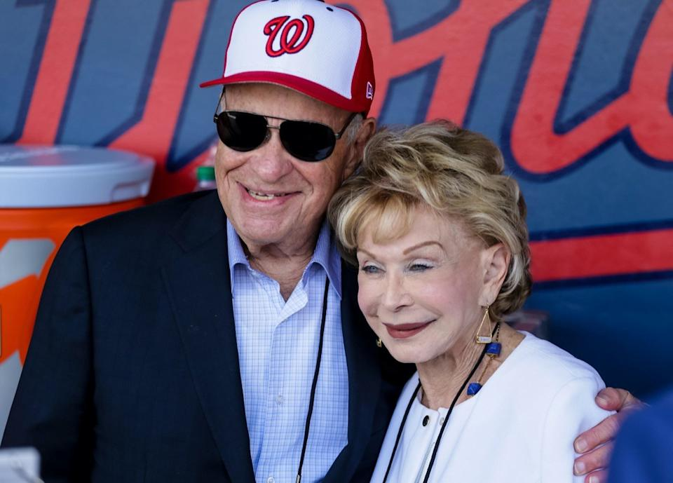 Nationals owner Ted Lerner hugs his wife Annette in the dugout during the opening day of Spring Training for the Washington Nationals and Houston Astros at the Ballpark of the Palm Beaches in West Palm Beach on February 28, 2017.