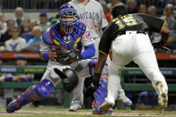 Chicago Cubs catcher Willson Contreras, left, moves into position to tag out Pittsburgh Pirates' Pablo Reyes who was attempting to score on a single by Erik Gonzalez during the second inning of a baseball game in Pittsburgh, Wednesday, Sept. 25, 2019. (AP Photo/Gene J. Puskar)