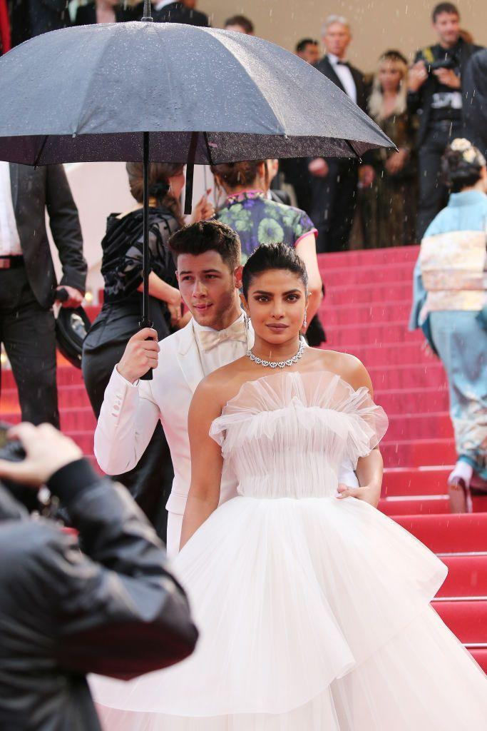"<p>Nick Jonas is the ultimate gentleman to shield Priyanka Chopra from the rain on the <a href=""https://www.elle.com/uk/fashion/celebrity-style/g27271385/cannes-red-carpet/"" rel=""nofollow noopener"" target=""_blank"" data-ylk=""slk:Cannes red carpet."" class=""link rapid-noclick-resp"">Cannes red carpet. </a></p>"