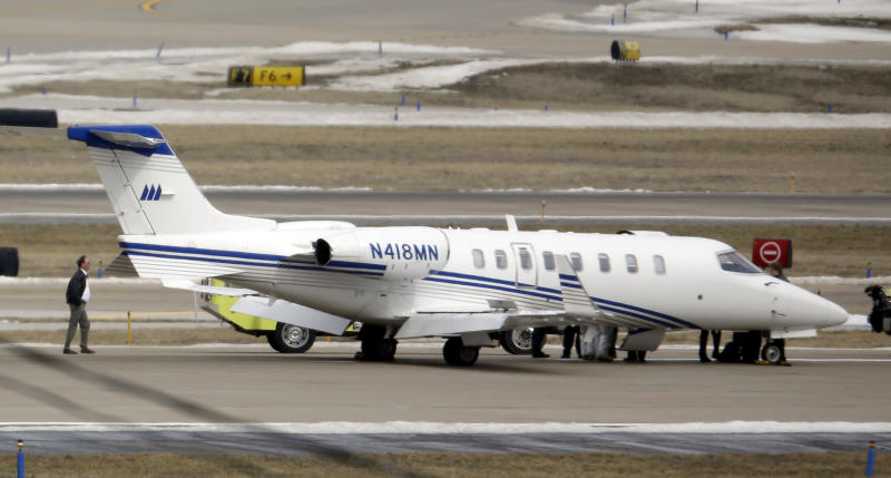 An aircraft sits on the tarmac after making an emergency landing at Lambert St. Louis International Airport Monday, March 4, 2013, in St. Louis. An official says the eight passengers aboard the small aircraft with landing gear troubles walked off the plane after it landed safely. (AP Photo/Jeff Roberson)