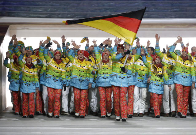 Maria Hoefl-Riesch of Germany carries the national flag as she leads the team during the opening ceremony of the 2014 Winter Olympics in Sochi, Russia, Friday, Feb. 7, 2014. (AP Photo/Mark Humphrey)