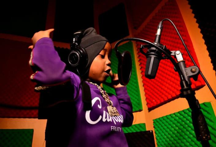 """Ugandan eight-year-old rapper """"Fresh Kid"""", whose real name is Patrick Ssenyonjo, records his music at the Badman Records studios in Kawempe Lugoba, in the outskirts of Kampala"""