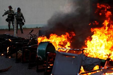 A barricade on fire set by  anti-government protesters is pictured during a demonstration in Sha Tin