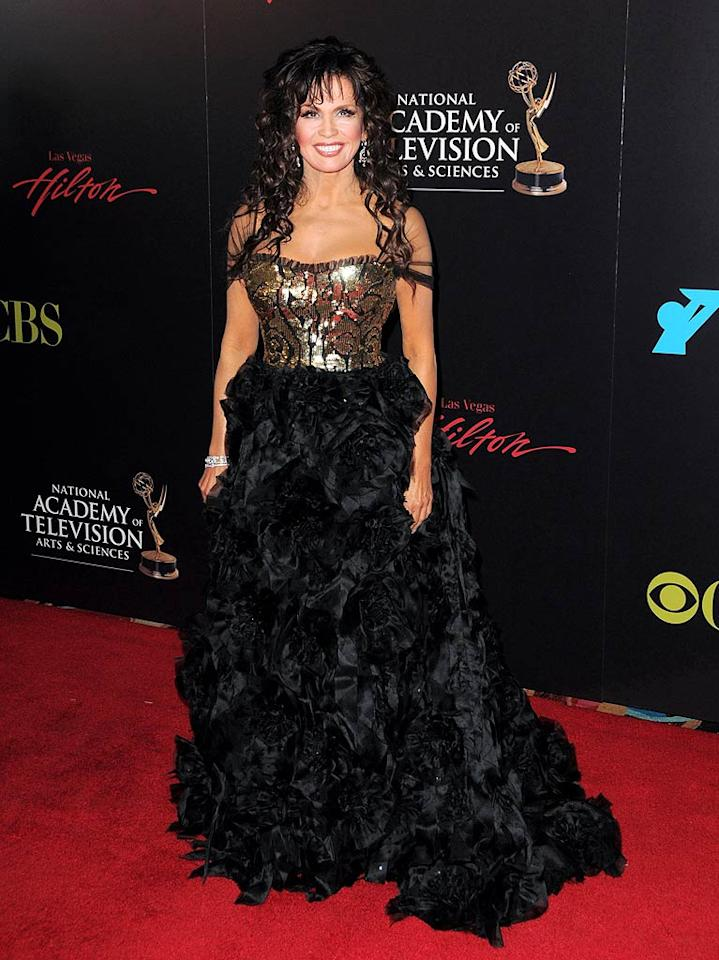 "Looking like one of the dolls she designs, Marie Osmond's frou frou gown, gold bodice, and country bumpkin ringlets were actually perfect for the always over-the-top Daytime Emmy Awards. Jordan Strauss/<a href=""http://www.wireimage.com"" target=""new"">WireImage.com</a> - June 27, 2010"