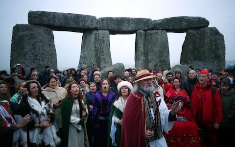 Druids and other worshippers celebrate the winter solstice at Stonehenge - Credit: Hannah McKay/Reuters
