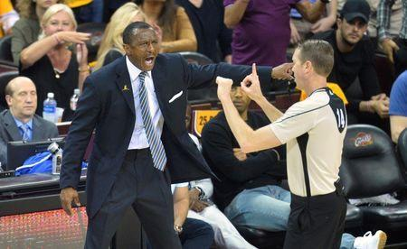May 25, 2016; Cleveland, OH, USA; Toronto Raptors head coach Dwane Casey yells beside referee Ed Malloy (14) in the second quarter against the Cleveland Cavaliers in game five of the Eastern conference finals of the NBA Playoffs at Quicken Loans Arena. Mandatory Credit: David Richard-USA TODAY Sports