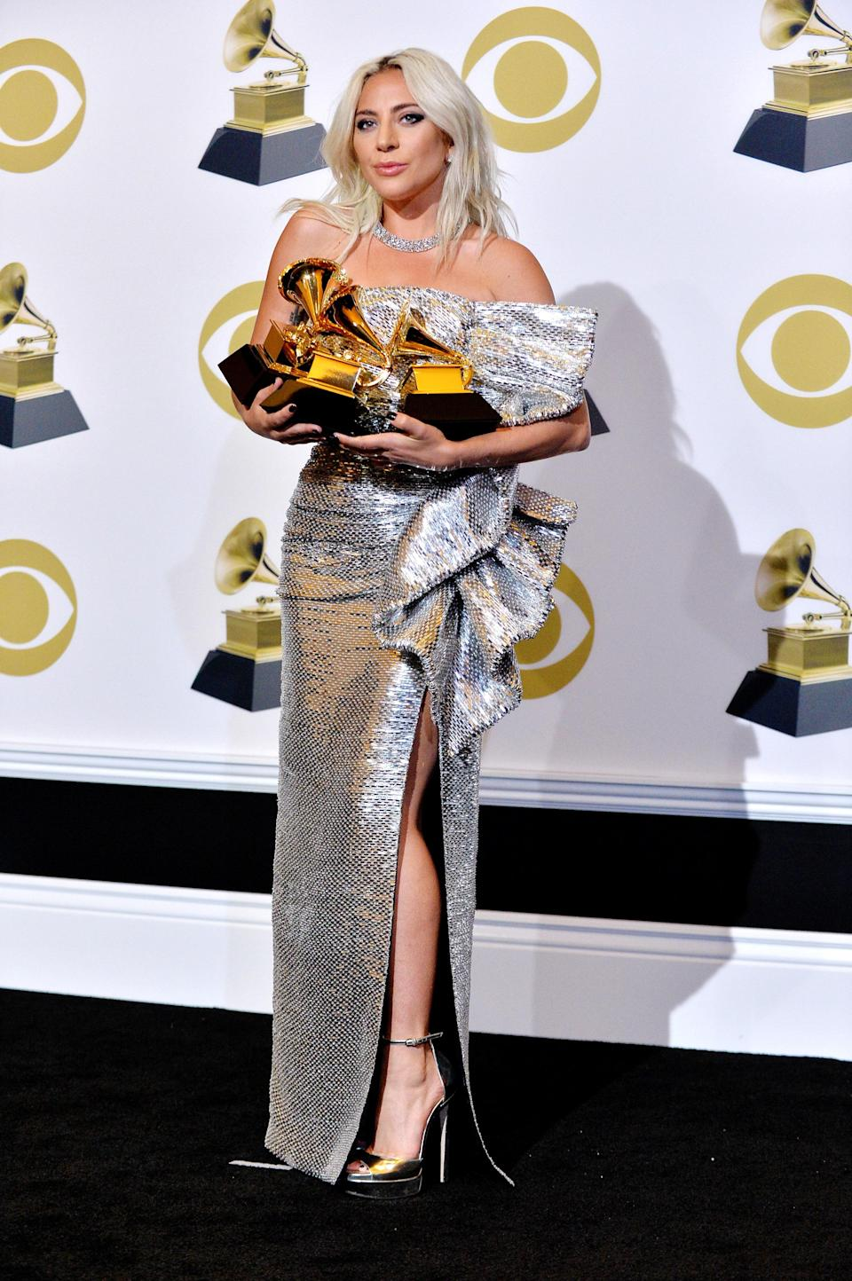 Grammys in hand, Lady Gaga showed the 2019 award show just how wide of a fashion range she truly has. Classic yet still fashion-forward with its shimmery metallic material, this dress is one of our red carpet favorites.