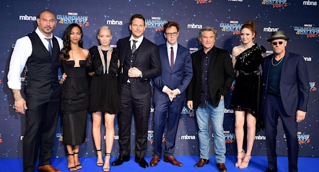 From left, Guardians <em> of the Galaxy Vol. 2</em> cast members Dave Bautista, Zoe Saldana, Pom Klementieff, Chris Pratt, James Gunn, Kurt Russell, Karen Gillan, and Michael Rooker. (Photo: Ian West/PA Images via Getty Images)