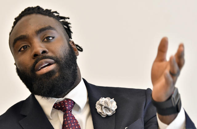 New Orleans Saints' Demario Davis speaks during a session to discuss criminal justice issues with other current and former NFL football players at Harvard Law School, Friday, March 23, 2018, in Cambridge, Mass. (AP Photo/Josh Reynolds)