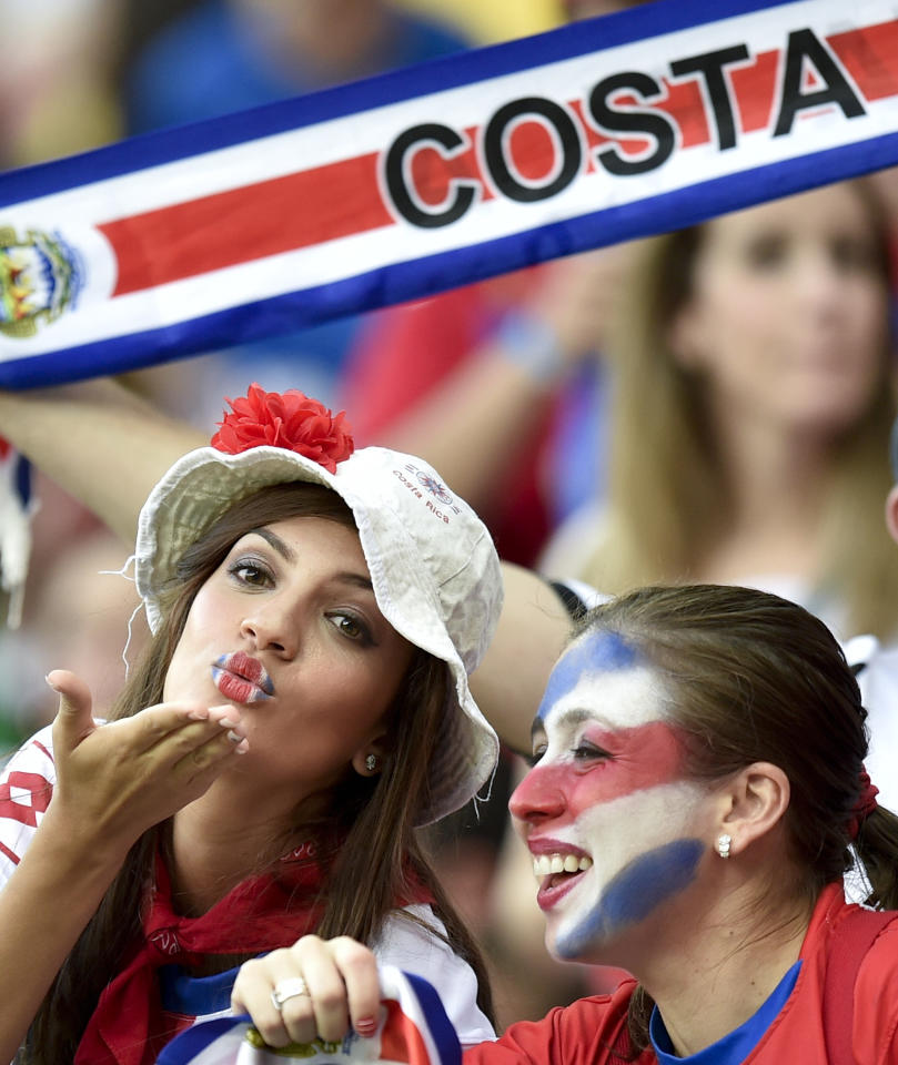 Costa Rica supporters wait for the start of the World Cup round of 16 soccer match between Costa Rica and Greece at the Arena Pernambuco in Recife, Brazil, Sunday, June 29, 2014. (AP Photo/Martin Meissner)