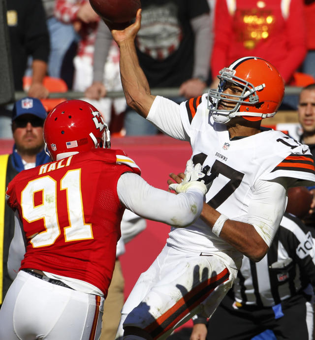 Cleveland Browns quarterback Jason Campbell (17) throws under pressure from Kansas City Chiefs outside linebacker Tamba Hali (91) during the second half of an NFL football game in Kansas City, Mo., Sunday, Oct. 27, 2013. (AP Photo/Colin E. Braley)