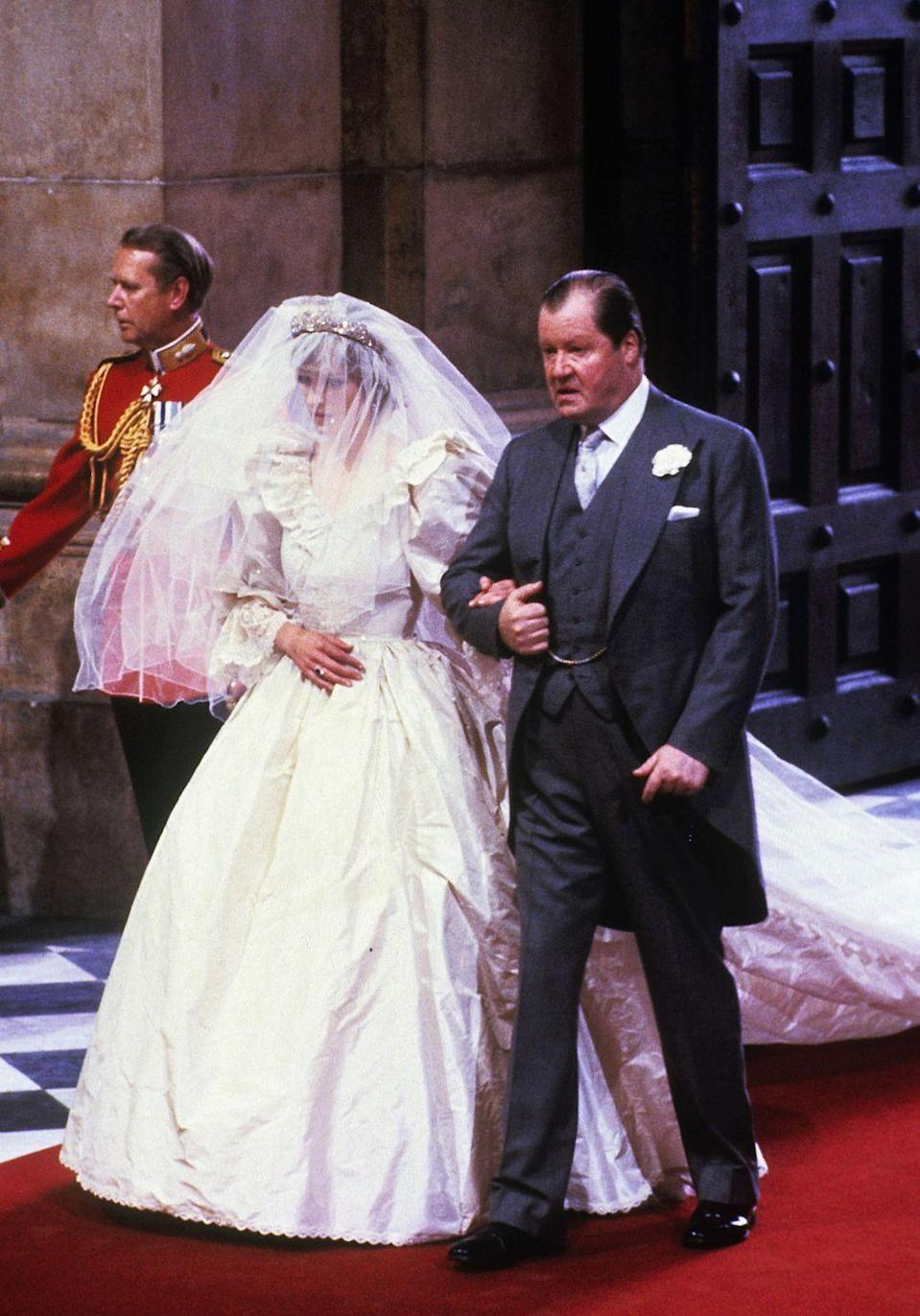 <p>Diana and her father make their way to the altar. Take a closer at the Spencer Tiara—yes, she wore her own family jewels for her big day.</p>
