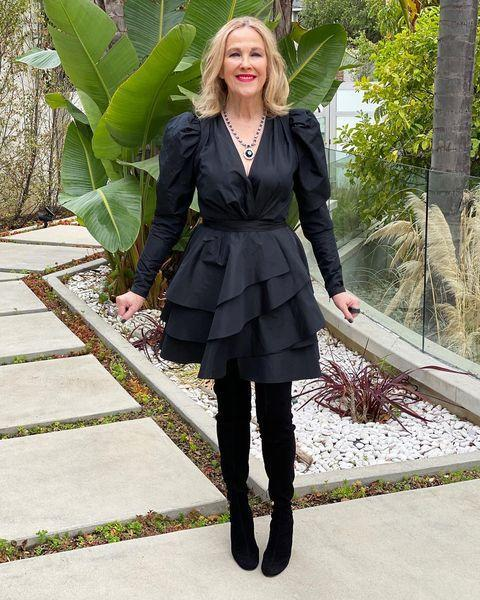<p>in a black Elie Saab LBD featuring a ruffled skirt, plus Jacob & Co. jewelry and a Stuart Weitzman boots. </p>