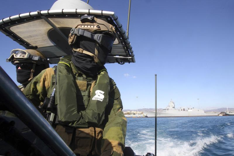 A member of the Norwegian Special Forces looks on during a sea patrol around a Norwegian frigate that docked at Limassol, December 14, 2013. A Danish-led task force was being readied in Cyprus on Saturday to remove the first part of Syria's deadly chemical stockpile, due before the end of this year. Under a deal worked out between the United States and Russia, Syria will relinquish control of deadly toxins which can be used to make sarin, VX gas and other lethal agents. Denmark and Norway plan to use two cargo vessels to transport the cargo out of the Syrian port city of Latakia, escorted by two frigates of their respective navies, and deliver it to the Organisation for the Prohibition of Chemical Weapons (OPCW) for destruction. REUTERS/Andreas Manolis (CYPRUS - Tags: MILITARY POLITICS)