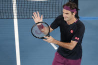 Switzerland's Roger Federer celebrates after defeating Serbia's Filip Krajinovic in their second round singles match at the Australian Open tennis championship in Melbourne, Australia, Wednesday, Jan. 22, 2020. (AP Photo/Lee Jin-man)