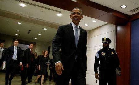 U.S. President Barack Obama leaves after his meeting with House and Senate Democrats to discuss a strategy on congressional Republicans' efforts to repeal the Affordable Care Act in the U.S. Capitol in Washington, DC, U.S. January 4, 2017. REUTERS/Kevin Lamarque