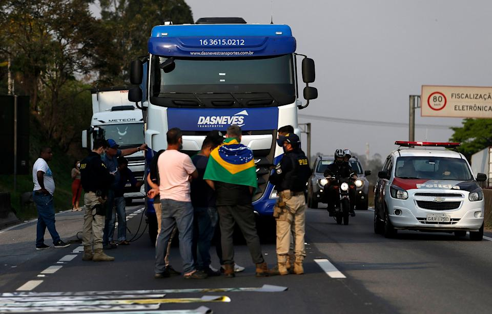 Truck drivers block the Regis Bittencourt road, 30 kilometres south of Sao Paulo, Brazil, during a demo in support of President Jair Bolsonaro, on September 9, 2021. (Photo by Miguel SCHINCARIOL / AFP) (Photo by MIGUEL SCHINCARIOL/AFP via Getty Images)