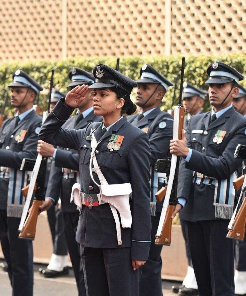 NEW DELHI, INDIA – DECEMBER 31: A woman Air Force officer salutes New Air Chief Marshal Birender Singh Dhanoa during his guard of honour ceremony at Air Force Headquarters before taking over from Air Chief Marshal Arup Raha on December 31, 2016 in New Delhi, India. The present Air Chief Marshal BS Dhanoa developed the country's aerial targeting philosophy against potential adversaries and transformed the concepts of air operations of the Indian Air Force to contemporary war fighting practices. (Photo by Vipin Kumar/Hindustan Times via Getty Images)