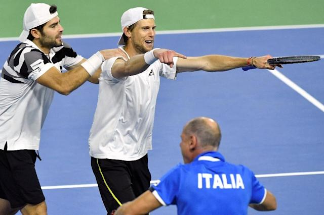 Italy's Simone Bolelli and Andreas Seppi celebrate after winning the third game of their Davis Cup World Group quarter-final against Belgium, in Charleroi, on April 8, 2017 (AFP Photo/Benoit Doppange)