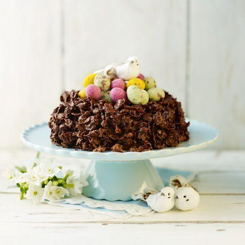 """<p>A delicious alternative to an Easter cake, this cornflake nest is a chocoholic's dream!<br> </p><p><strong>Recipe: <a href=""""https://www.goodhousekeeping.com/uk/food/recipes/giant-chocolate-cornflake-nest"""" rel=""""nofollow noopener"""" target=""""_blank"""" data-ylk=""""slk:Giant chocolate cornflake nest"""" class=""""link rapid-noclick-resp"""">Giant chocolate cornflake nest</a></strong></p>"""