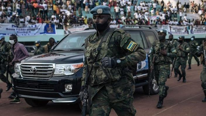 The motorcade of the President of the Central African Republic, arrives at the 20,000-seat stadium, for an electoral rally, escorted by the presidential guard, Russian mercenaries, and Rwandan UN peacekeepers