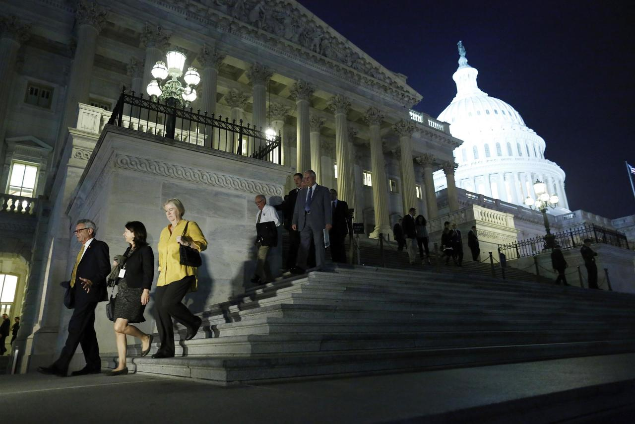 Members of the U.S. House of Representatives depart after a late-night vote on fiscal legislation to end the government shutdown, at the U.S. Capitol in Washington, October 16, 2013. The U.S. Congress on Wednesday approved an 11th-hour deal to end a partial government shutdown and pull the world's biggest economy back from the brink of a historic debt default that could have threatened financial calamity. REUTERS/Jonathan Ernst (UNITED STATES - Tags: POLITICS BUSINESS)