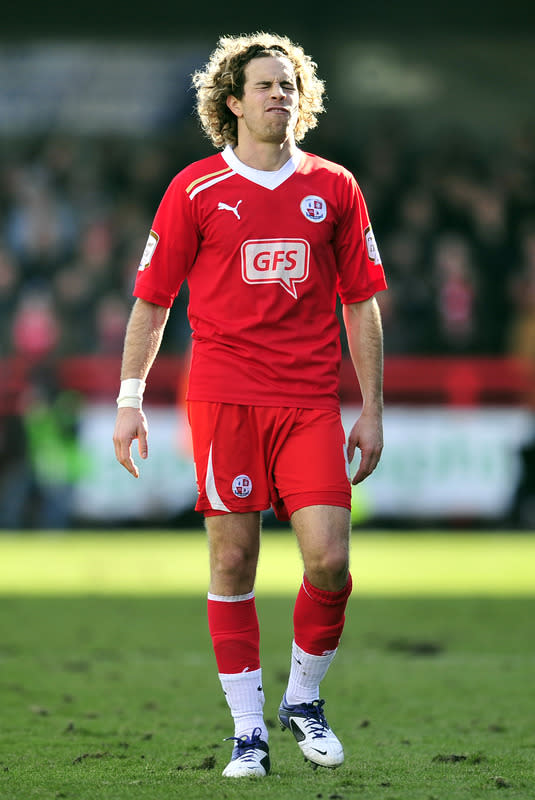 "Crawley Town's Argentine midfielder Sergio Torres grimaces during their FA Cup fifth round football match against Stoke City at Broadfield Stadium in Crawley, England on February 19, 2012.                                                                                                                RESTRICTED TO EDITORIAL USE. No use with unauthorized audio, video, data, fixture lists, club/league logos or ""live"" services. Online in-match use limited to 45 images, no video emulation. No use in betting, games or single club/league/player publications. (Photo by Glyn Kirk/AFP/Getty Images)"