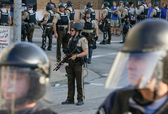 <p>St. Louis Police Department officers stand on the street in riot gear after a not guilty verdict in the murder trial of Jason Stockley, a former St. Louis police officer, charged with the 2011 shooting of Anthony Lamar Smith, who was black, in St. Louis, Mo., Sept. 15, 2017. (Photo: Lawrence Bryant/Reuters) </p>