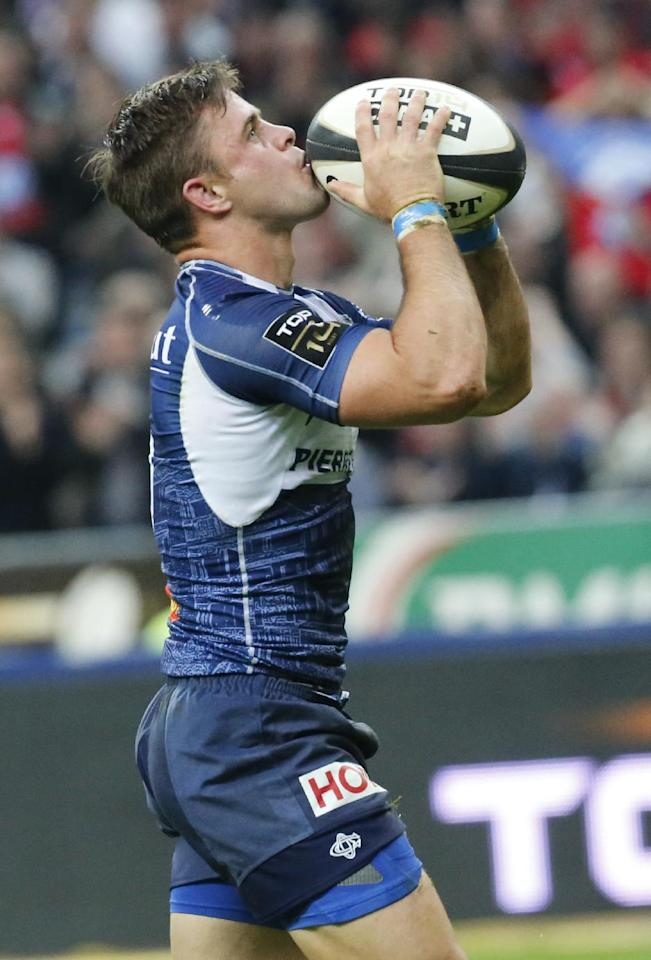 Rory Kockott, of Castres celebrates after scoring a try, against Toulon during their Top 14 final rugby match, at Stade de France stadium in Saint Denis, north of Paris, France, Saturday, June 1 2013. (AP Photo/Jacques Brinon)