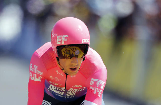 Canada's Michael Woods crosses the finish line during the thirteenth stage of the Tour de France cycling race, an individual time trial over 27.2 kilometers (16.9 miles) with start and finish in Pau, France, Friday, July 19, 2019. Unusually, Woods is a rookie at cycling's greatest race at the ripe age of 32 and also has an unusual back story as a former track athlete who switched late to pro cycling. (AP Photo/Christophe Ena)