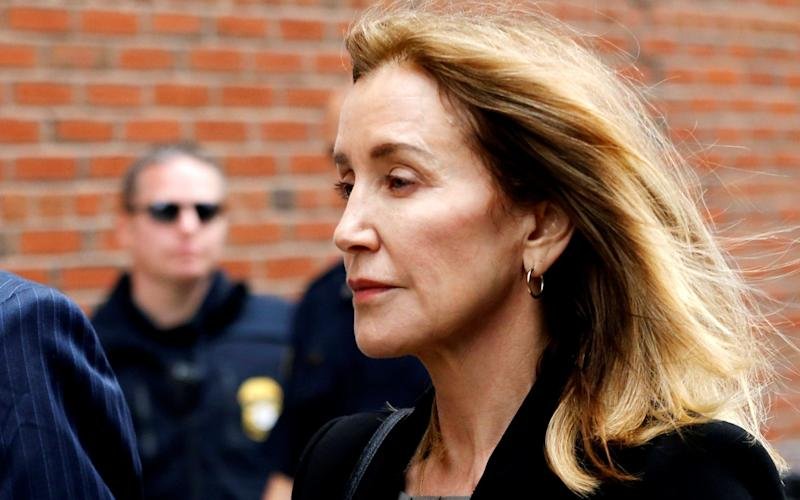Actor Felicity Huffman said it was to her 'eternal shame' that she did not pull out of the scheme  - REUTERS