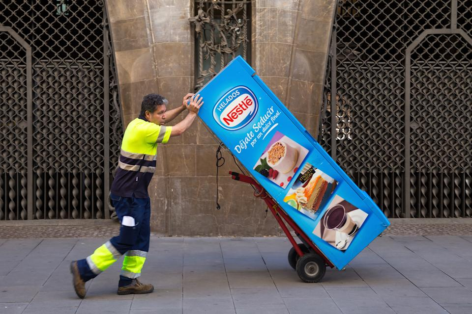 BARCELONA, SPAIN - MAY 15, 2017: Unknown worker take away coffee automat in center of Barcelona.