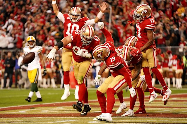 Jimmy Garoppolo (10) and Ben Garland (63) of the San Francisco 49ers celebrate a touchdown by Raheem Mostert. (Photo by Thearon W. Henderson/Getty Images)