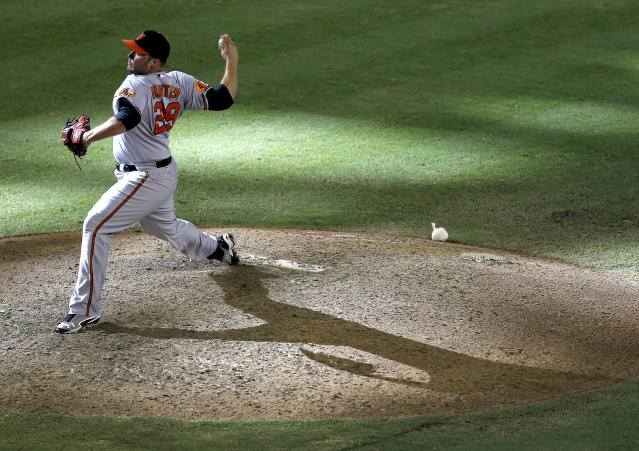 Baltimore Orioles pitcher Tommy Hunter delivers a pitch against the Arizona Diamondbacks during the 13th inning of a baseball game, Wednesday, Aug. 14, 2013, in Phoenix. (AP Photo/Matt York)