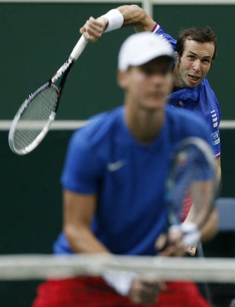 Czech Republic's Tomas Berdych, left, looks on as his teammate Radek Stepanek, right, serves to Spain's Marcel Granollers and Marc Lopez during their tennis Davis Cup final doubles match in Prague, Czech Republic, Saturday, Nov. 17, 2012. (AP Photo/Petr David Josek)